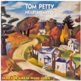 Download or print Tom Petty And The Heartbreakers Into The Great Wide Open Sheet Music Printable PDF -page score for Rock / arranged Guitar with strumming patterns SKU: 57268.